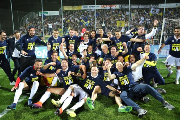 Parma players celebrate after securing their third straight promotion. Photograph Simone Arveda EPA